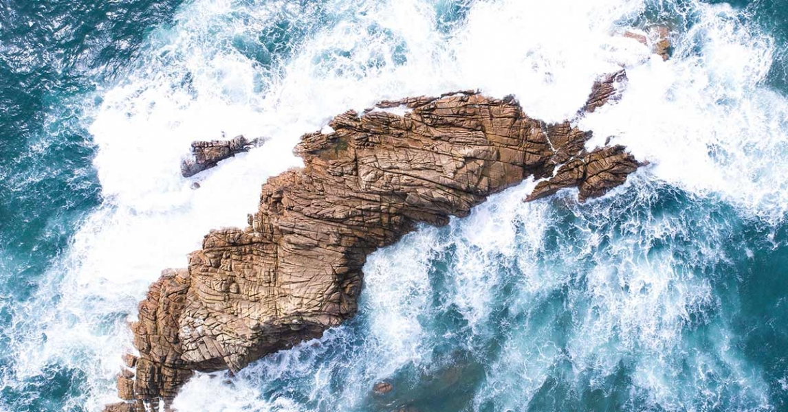 Sea waves against a rock