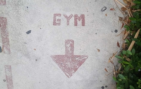Gym sign on the pavement